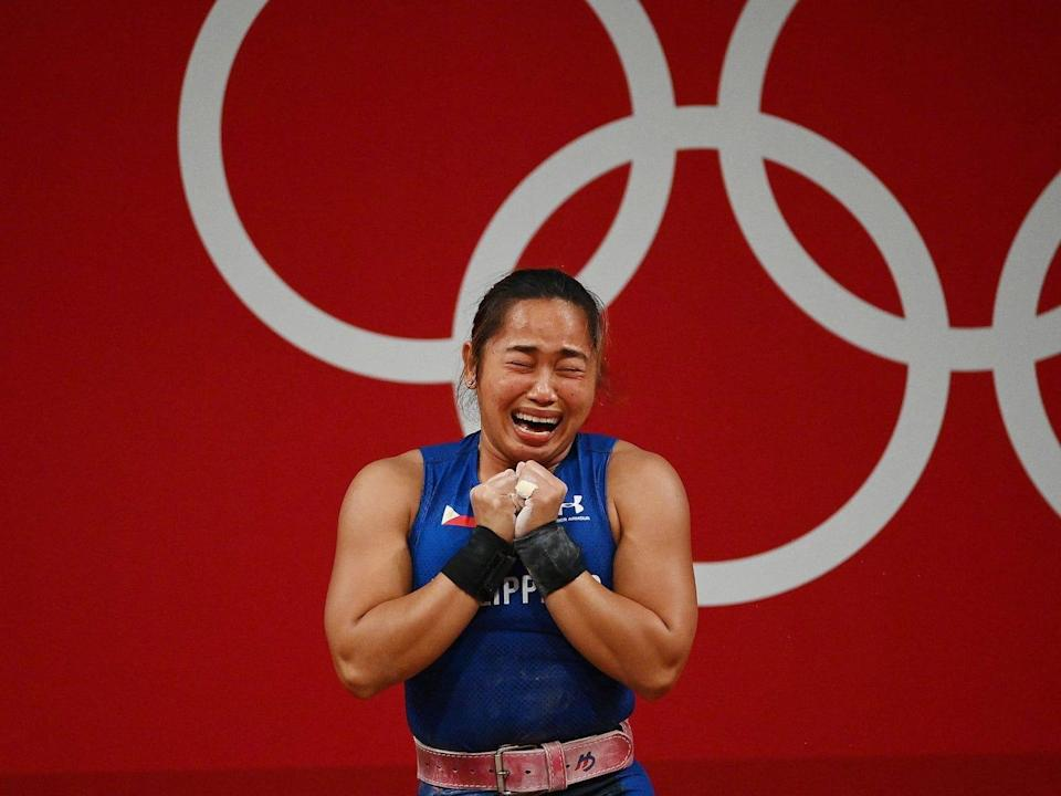 Hidilyn Diaz cries after winning gold at the Tokyo Olympics.