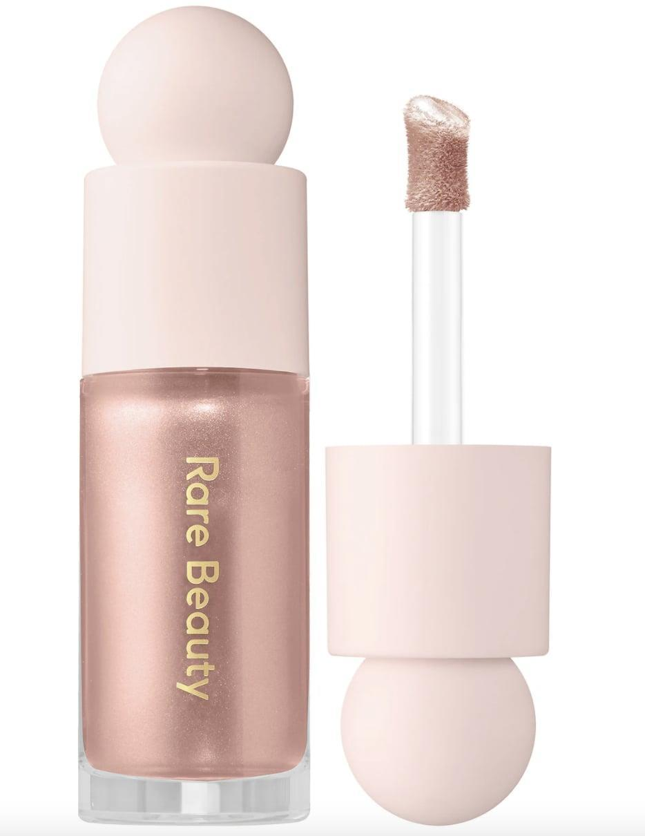<p>The <span>Rare Beauty Positive Light Liquid Luminizer</span> ($22) is an editor-favorite. The liquid consistency makes it easy to blend into skin for an all-over glow. </p>