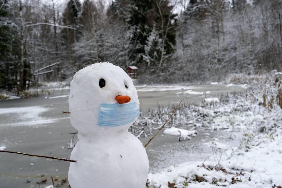 A snowman in a face mask.