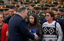 US Secretary of State Mike Pompeo in January 2020 greets relatives of victims of a car-bomb attack in Bogota that he has cited to justify a terrorism designation to Cuba, where rebel commanders have been staying