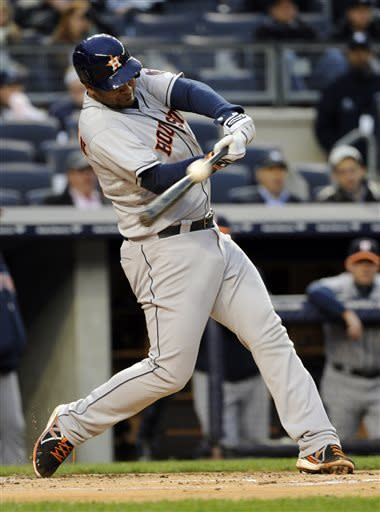 Houston Astros batter Carlos Coporan hits a two-run double during the first inning of a baseball game New York against the Yankees Monday, April 29, 2013, at Yankee Stadium in New York. (AP Photo/Bill Kostroun)