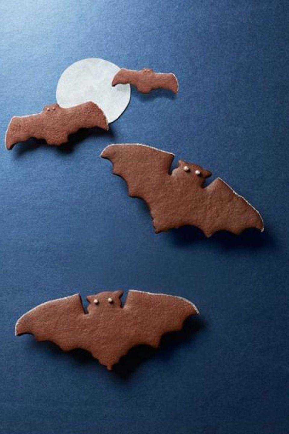 """<p>Spice it up this Halloween with these chocolatey bat cookies, flavored with cinnamon and cardamom.</p><p><strong><a href=""""https://www.countryliving.com/food-drinks/recipes/a5688/spiced-chocolate-bat-cookies-recipe-clx1014/"""" rel=""""nofollow noopener"""" target=""""_blank"""" data-ylk=""""slk:Get the recipe"""" class=""""link rapid-noclick-resp"""">Get the recipe</a></strong>.  </p>"""