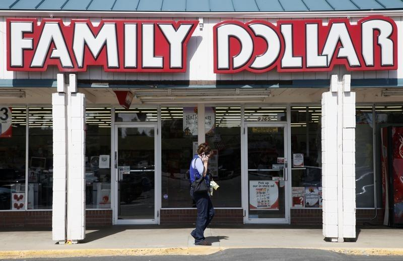 A woman walks by the Family Dollar store in Arvada