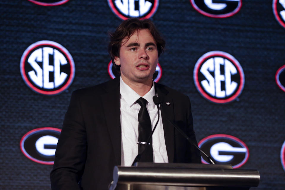 FILE - Georgia's JT Daniels speaks to reporters during the NCAA college football Southeastern Conference Media Days Tuesday, July 20, 2021, in Hoover, Ala. Daniels starred for a powerhouse team in high school. He launched his college career at one of the most storied programs in the nation. Yet none of that quite prepared this laid-back Californian for the passion that goes along with playing for the Georgia Bulldogs, for playing in the Southeastern Conference. (AP Photo/Butch Dill, File)