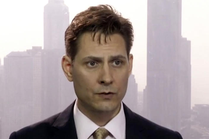 FILE - In this file image made from a March 28, 2018, video, Michael Kovrig, an adviser with the International Crisis Group, a Brussels-based non-governmental organization, speaks during an interview in Hong Kong. The Canadian government says China will begin trials in March 2021 for two Canadians, Kovrig and Michael Spavor, who were arrested in 2019 in apparent retaliation for Canada's detention of a senior executive for Chinese communications giant Huawei Technologies. (AP Photo/File)