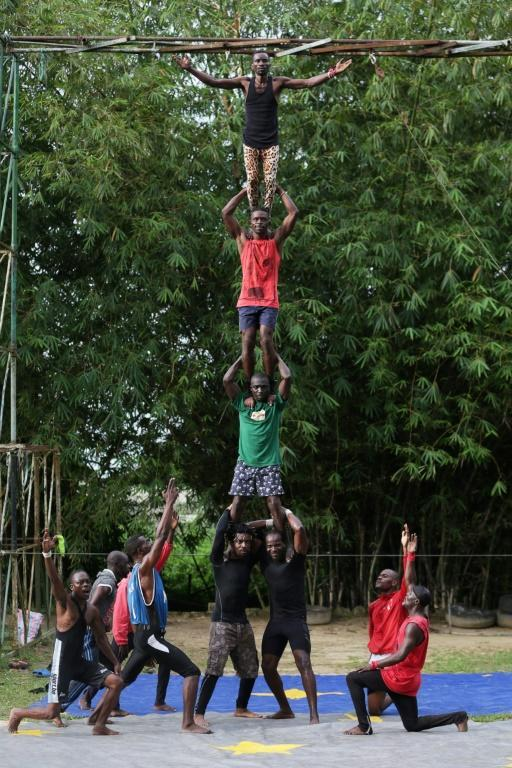The acrobats perform risky feats, but the circus can no longer afford safety equipment