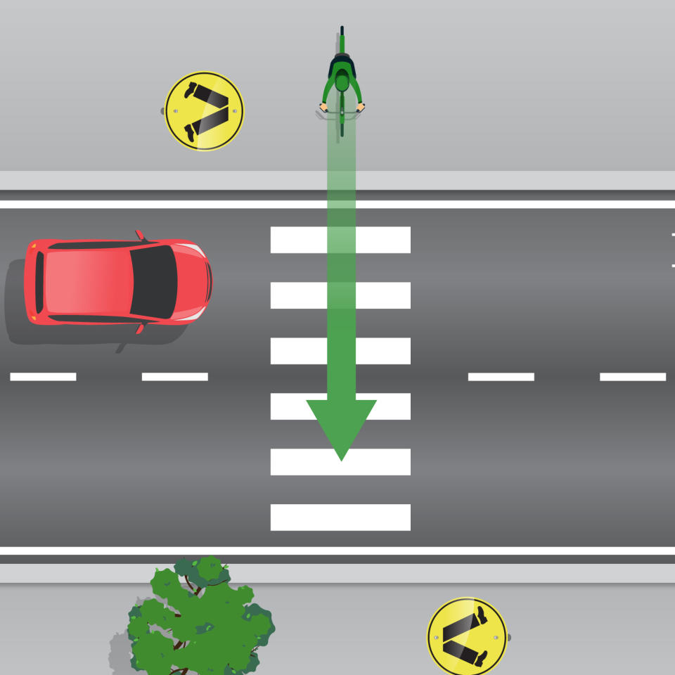 A cyclist is pictured preparing to use a pedestrian crossing.