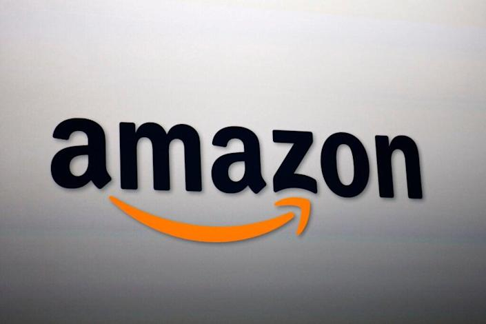 The Amazon logo is projected onto a screen at a press conference on September 6, 2012 in Santa Monica, California. Amazon unveiled the Kindle Paperwhite and the Kindle Fire HD in 7 and 8.9-inch sizes. (Photo by David McNew/Getty Images)