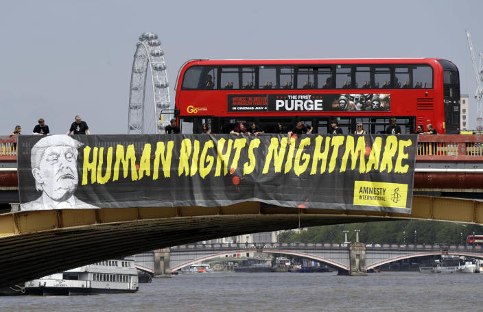 """<p>A giant """"Human Rights Nightmare"""" banner is unfurled by Amnesty International activists across the river Thames on Vauxhall Bridge to protest against the visit of U.S. President Donald Trump, in London, July 12, 2018. (Photo: Luca Bruno/AP) </p>"""