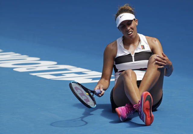 United States' Madison Keys reacts after falling during her first round match against Australia's Destanee Aiava at the Australian Open tennis championships in Melbourne, Australia, Tuesday, Jan. 15, 2019. (AP Photo/Kin Cheung)