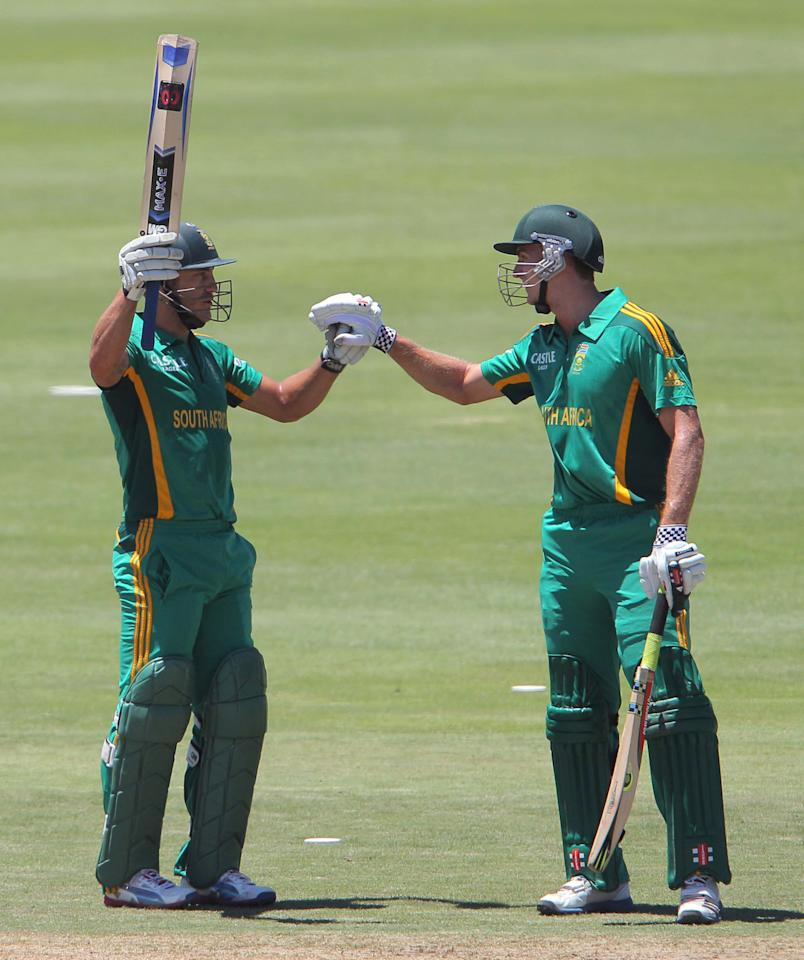 PAARL, SOUTH AFRICA - JANUARY 19: Faf du Plessis from the Proteas celebrates his 50 with Ryan McLaren from the Proteas during the 1st One Day International match between South Africa and New Zealand at Boland Park on January 19, 2013 in Paarl, South Africa (Photo by Carl Fourie/Gallo Images/Getty Images)