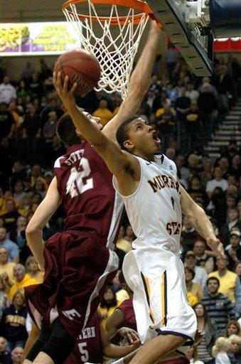 Murray State's Stacy Wilson (1) shoots as Eastern Kentucky's Eric Stutz (42) goes in for a block attempt in the second half of an NCAA college basketball game, Wednesday, Jan. 4, 2012, in Murray, Ky. (AP Photo/Stephen Lance Dennee)