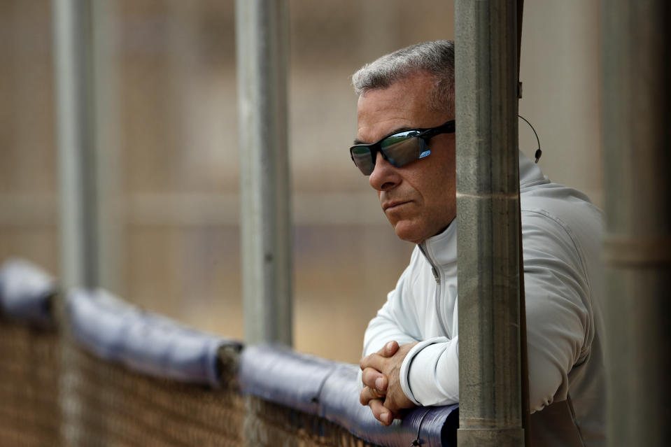 FILE - In this Feb. 13, 2019, file photo, Kansas City Royals general manager Dayton Moore watches a workout during spring training baseball practice in Surprise, Ariz. For a number of rebuilding teams, the 2020 baseball season was supposed to be another step in the progression of their top prospects eventually reaching the big leagues. You want to be 100 percent sure a player is ready to help you at the major league level before you add them. Theres no minor leagues to send them down to if they struggle at the major league level, Moore said.(AP Photo/Charlie Riedel, File)
