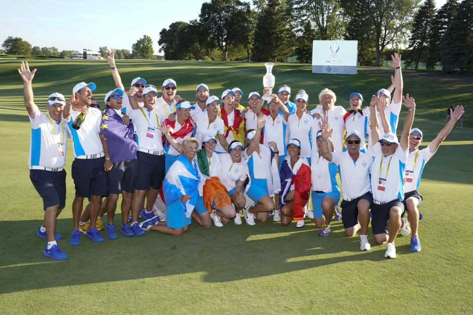 Team Europe poses after they defeated the United States at the Solheim Cup golf tournament, Monday, Sept. 6, 2021, in Toledo, Ohio. (AP Photo/Carlos Osorio)