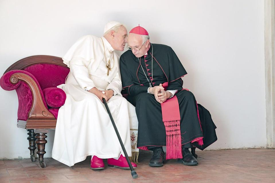"""<p>Based on Anthony McCarten's 2017 play <strong>The Pope</strong>, this biographical dramedy stars <a class=""""link rapid-noclick-resp"""" href=""""https://www.popsugar.com/latest/Anthony-Hopkins"""" rel=""""nofollow noopener"""" target=""""_blank"""" data-ylk=""""slk:Anthony Hopkins"""">Anthony Hopkins</a> and Jonathan Pryce as conservative Pope Benedict XVI and liberal Cardinal Jorge Mario Bergoglio (i.e. the future Pope Francis), centering on their relationship as they attempt to forge a new path for the Catholic Church together, despite their wildly different opinions. You definitely don't have to be Catholic to appreciate the tender, unexpected bond that forms between these two. </p> <p><a href=""""http://www.netflix.com/title/80174451"""" class=""""link rapid-noclick-resp"""" rel=""""nofollow noopener"""" target=""""_blank"""" data-ylk=""""slk:Watch The Two Popes on Netflix"""">Watch<strong> The Two Popes </strong>on Netflix</a>.<br></p>"""