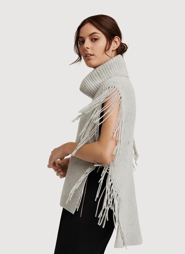 """<p>Sometimes you want to be basic but with a little extra panache. That's where Kit & Ace's merino wool and cashmere blend poncho comes into play, blending style and comfort in perfect harmony.<i> Get it <a href=""""https://www.kitandace.com/ca/en/Women/Sweaters-and-Jackets/p/Fringe-Benefits-Poncho/KW521014?color=KW521014-10831"""">here</a>.</i></p>"""