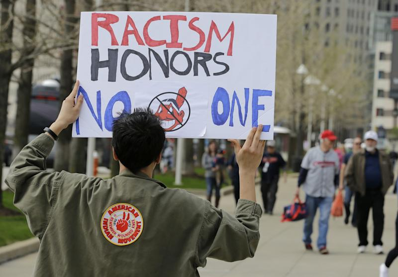 A protester outside of Progressive Field before the Indians' home opener. (AP)