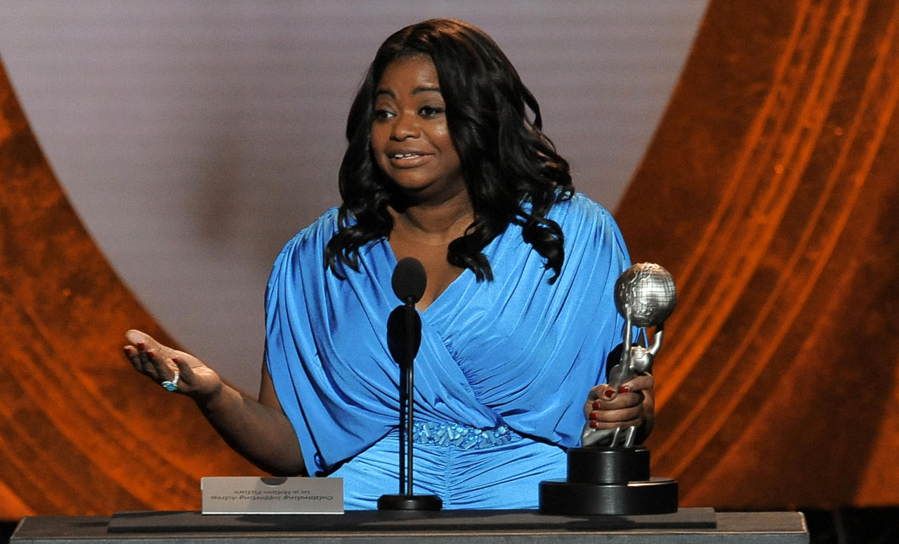"Octavia Spencer accepts the award for outstanding supporting actress in a motion picture for ""The Help"" at the 43rd NAACP Image Awards on Friday, Feb. 17, 2012, in Los Angeles. (AP Photo/Chris Pizzello)"