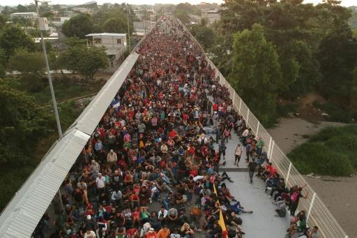 Central American migrants at the international bridge connecting Tecum Uman, Guatemala, with Ciudad Hidalgo, Mexico