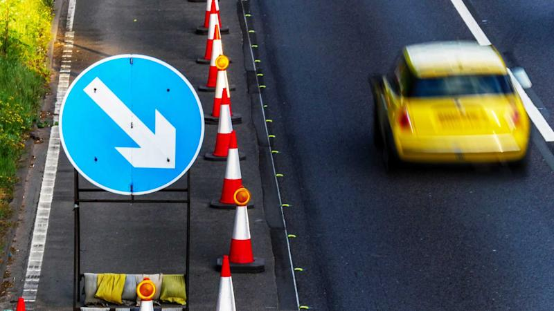 UK roadworks cones and directional signs on motorway