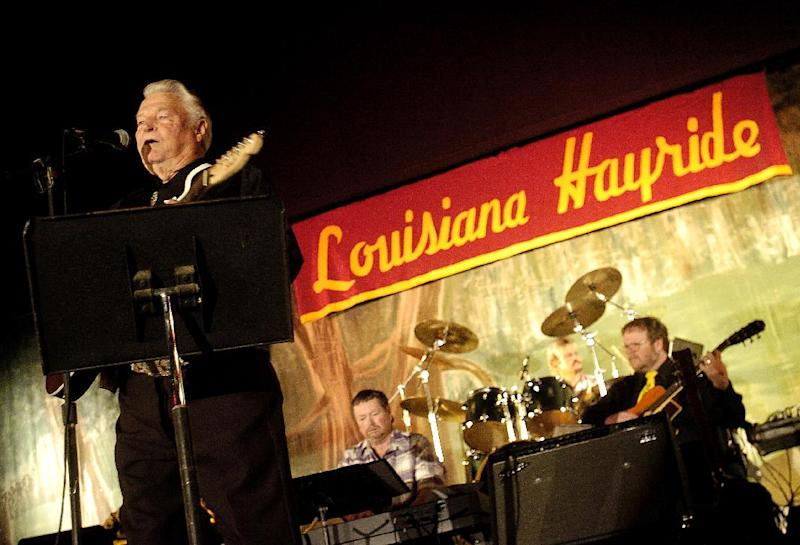 """In a Feb. 24, 2008 photo Country musician Claude King performs during a Louisiana Hayride show at the Municipal Auditorium in Shreveport, La. Country singer-songwriter Claude King, an original member of the Louisiana Hayride who was best known for the 1962 hit """"Wolverton Mountain,"""" has died. He was 90. (AP Photo/The Shreveport Times, Val Horvath) MAGS OUT; MANDATORY CREDIT SHREVEPORTTIMES.COM; NO SALES"""
