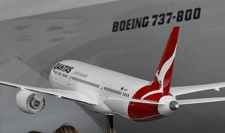 A model of a Boeing 787-9 Dreamliner in Qantas livery is shown during an event marking the 95th anniversary of the Airline at the Qantas Hangar at Sydney International Airport