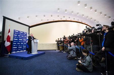 Toronto Mayor Rob Ford makes a statement about his personal life and the Capital and Operating Budgets meeting that had just finished at City Hall in Toronto, January 22, 2014. REUTERS/Mark Blinch