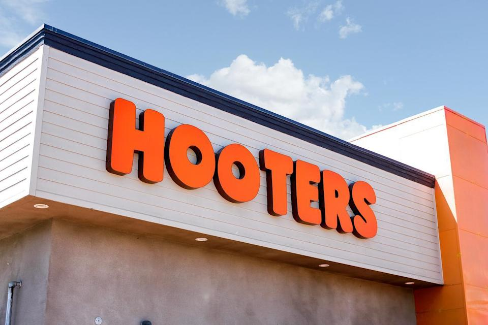 """<p>Hooters locations are reopening as state and local governments allow. Team members are required to <a href=""""https://www.thedailymeal.com/eat/gloves-grocery-store-coronavirus-social-distancing?referrer=yahoo&category=beauty_food&include_utm=1&utm_medium=referral&utm_source=yahoo&utm_campaign=feed"""" rel=""""nofollow noopener"""" target=""""_blank"""" data-ylk=""""slk:wear gloves"""" class=""""link rapid-noclick-resp"""">wear gloves</a> and masks at all times. They also must wash their hands at least once every 30 minutes and have their temperature checked at the start of each shift. All guests are required to use <a href=""""https://www.theactivetimes.com/hand-sanitizer-effective-washing-hands?referrer=yahoo&category=beauty_food&include_utm=1&utm_medium=referral&utm_source=yahoo&utm_campaign=feed"""" rel=""""nofollow noopener"""" target=""""_blank"""" data-ylk=""""slk:hand sanitizer"""" class=""""link rapid-noclick-resp"""">hand sanitizer</a> upon entrance and are encouraged to wear a face covering.</p>"""
