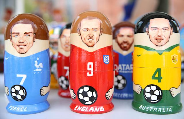 Cashing in: Harry Kane, Antoine Griezmann and Brazil's Pedro Geromel feature on World Cup souvenirs on sale in Moscow. (PA)