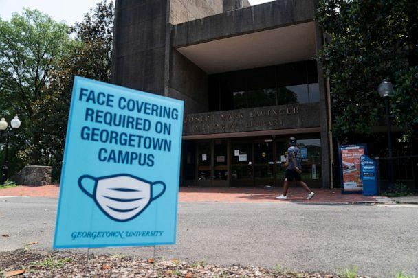 PHOTO: A sign reminding people to wear face masks sits in front of a library on Georgetown University's main campus in Washington, D.C., July 7, 2020. (Xinhua News Agency via Getty Images)