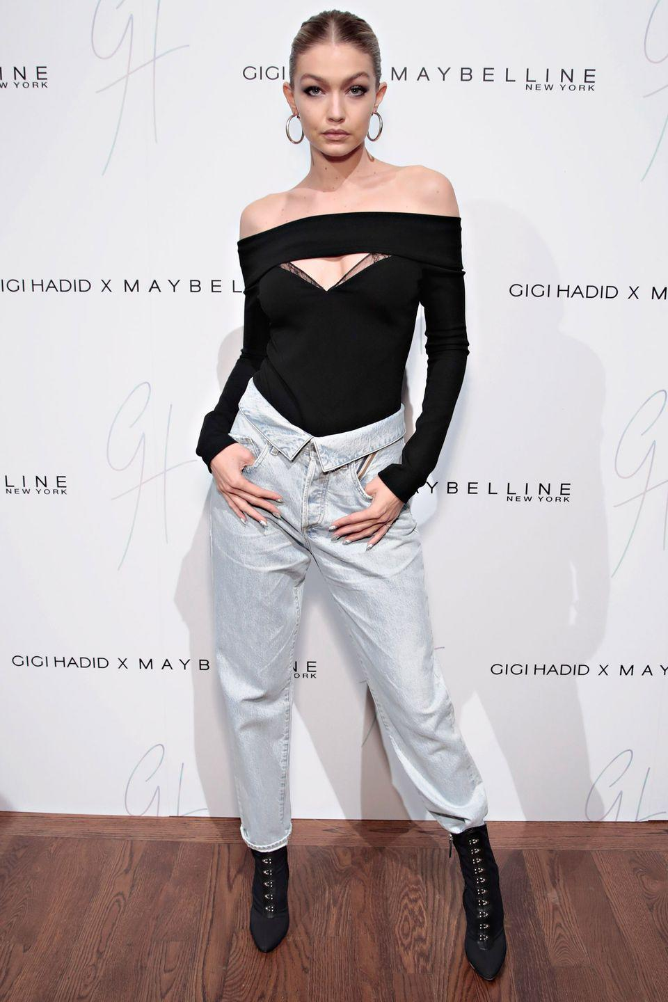 <p>In Jean Atelier body suit and jeans, Giuseppe Zanotti booties, and Luv AJ hoop earrings at the Gigi Hadid x Maybelline New York International Launch Party in NYC.</p>