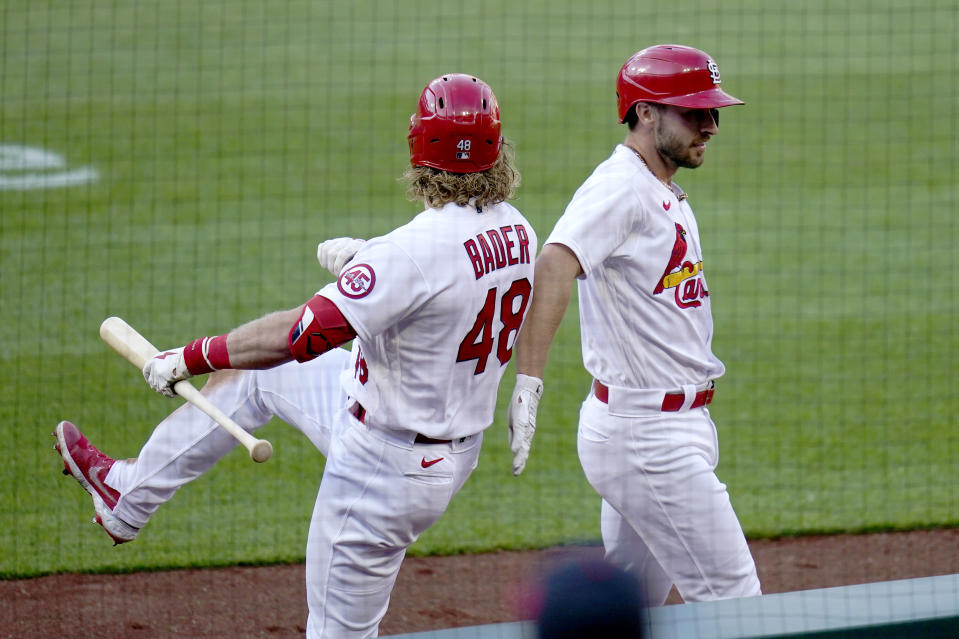 St. Louis Cardinals' Paul DeJong, right, is congratulated by teammate Harrison Bader (48) after hitting a two-run home run during the fifth inning in the first game of a baseball doubleheader against the New York Mets Wednesday, May 5, 2021, in St. Louis. (AP Photo/Jeff Roberson)