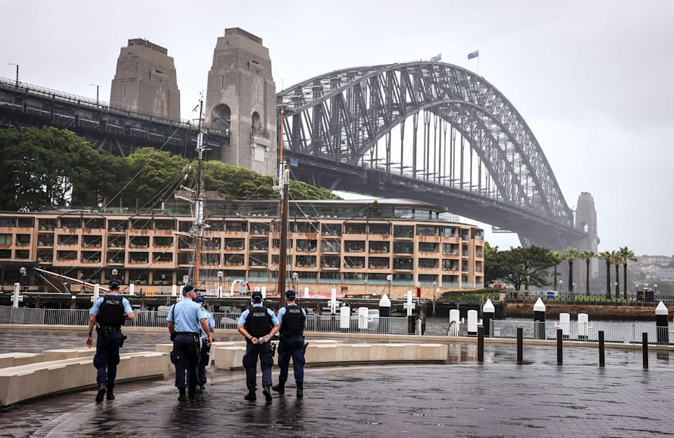 New South Wales police officers patrol an area in front of the Harbour Bridge  in central Sydney on 31 December, 2020. Police are investigating after a group of Sikh men were attacked in a vehicle. (AFP via Getty Images)