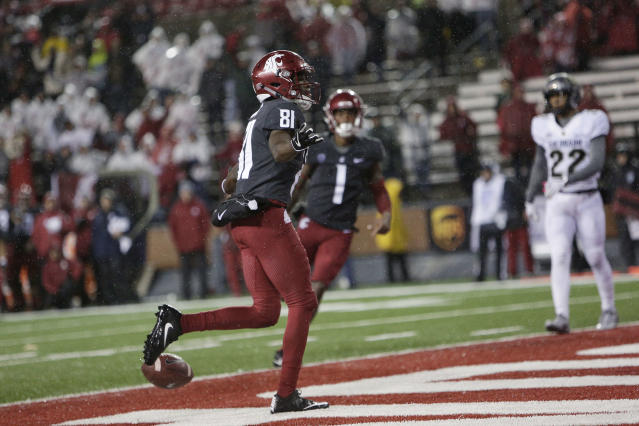 Washington State wide receiver Renard Bell (81) celebrates his touchdown catch during the second half of an NCAA college football game against Colorado in Pullman, Wash., Saturday, Oct. 21, 2017. Washington State won 28-0. (AP Photo/Young Kwak)