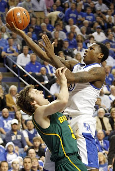Kentucky's Archie Goodwin, right, shoots over Baylor's Brady Heslip during the first half of an NCAA college basketball game at Rupp Arena in Lexington, Ky., Saturday, Dec. 1, 2012. (AP Photo/James Crisp)