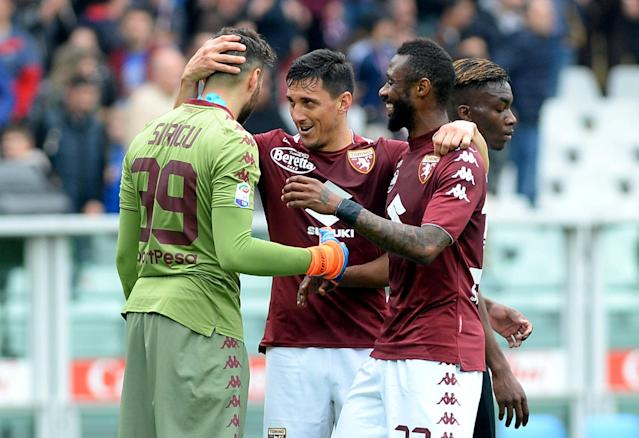 Soccer Football - Serie A - Torino vs Inter Milan - Stadio Olimpico Grande Torino, Turin, Italy - April 8, 2018 Torino's Salvatore Sirigu celebrates with teammates after the match REUTERS/Massimo Pinca