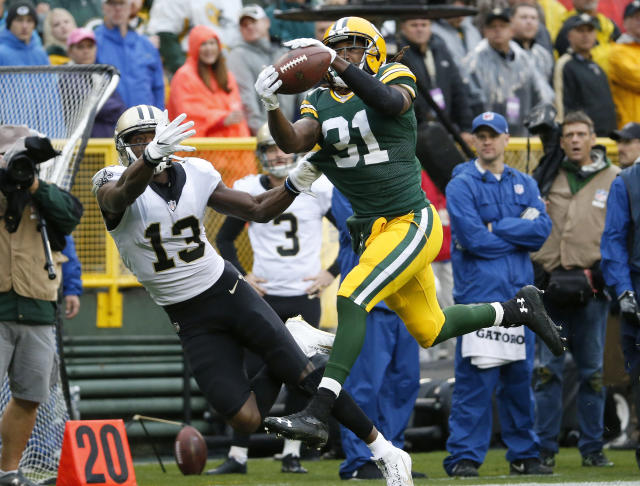 <p>Green Bay Packers cornerback Davon House (31) intercepts a pass intended for New Orleans Saints wide receiver Michael Thomas (13) during the first half of an NFL football game, Sunday, Oct. 22, 2017, in Green Bay, Wis. (AP Photo/Mike Roemer) </p>