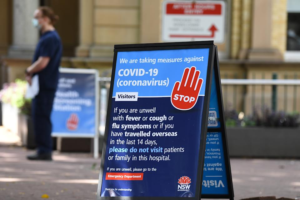 Staff wearing face masks outside the Royal Prince Alfred Hospital (RPA) in Camperdown. Source: AAP