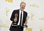 """FILE - Jon Stewart, winner of the awards for outstanding writing for a variety series and outstanding variety talk show for """"The Daily Show with Jon Stewart"""", poses in the press room at the 67th Primetime Emmy Awards on Sept. 20, 2015 in Los Angeles. Comedy Central's """"The Daily Show,"""" launched 25 years ago this month, dedicated to skewering journalism and warning viewers about how they take in their news. (Photo by Jordan Strauss/Invision/AP, File)"""