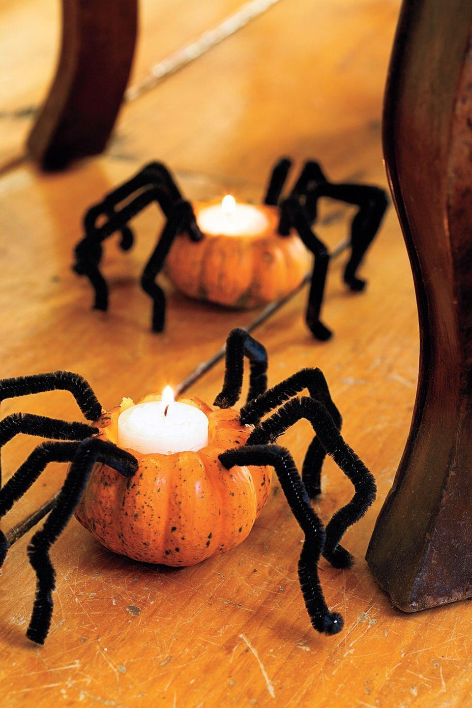 """<p>Light up the party with a spooky trail of spiders. Bent pipe cleaners bring to mind hairy tarantula legs when attached to mini pumpkins.  </p><p><a class=""""link rapid-noclick-resp"""" href=""""https://www.amazon.com/Zion-Judaica-Quality-Tealight-Unscented/dp/B00DUF1ANI/?tag=syn-yahoo-20&ascsubtag=%5Bartid%7C10055.g.238%5Bsrc%7Cyahoo-us"""" rel=""""nofollow noopener"""" target=""""_blank"""" data-ylk=""""slk:SHOP TEALIGHTS"""">SHOP TEALIGHTS</a></p>"""