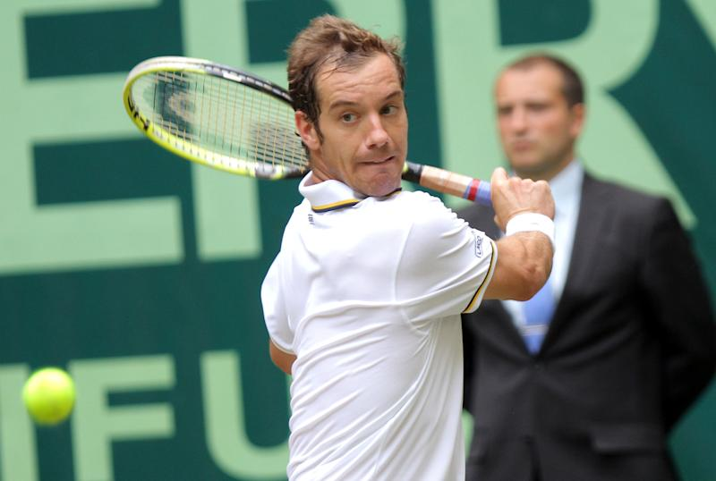 Richard Gasquet of France returns a shot to Germany's Florian Mayer during their match at the Gerry Weber Open tennis tournament in Halle, Germany, Friday, June 14, 2013. (AP Photo/dpa, Oliver Krato)