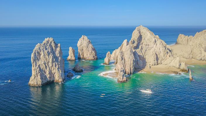 """<p><a href=""""https://www.cntraveler.com/stories/2016-05-13/top-things-to-do-in-los-cabos-mexico?mbid=synd_yahoo_rss"""" rel=""""nofollow noopener"""" target=""""_blank"""" data-ylk=""""slk:Cabo San Lucas"""" class=""""link rapid-noclick-resp"""">Cabo San Lucas</a> has long been the favorite landing spot of party-ready spring breakers, but you're likely to find a more laidback crowd during Memorial Day Weekend. Charter a boat to see the famous El Arco rock formation and do some snorkeling, then head back to town for some seriously delicious Mexican food. We recommend <a href=""""https://cna.st/affiliate-link/2BDDVBo7Xv7ci7U8GXY4aWhD4gHa1VrZ2DnQFGoM7pF9MmFWpASRSgAykyYpzPm3srqt6uL57JqjGqRMLv8q7Hvm5xytdkwdueQEZdQF14KuCHUUBGJmYbvVGmVqBGY68zg2cRUewj1MexiFFU6Ph7qgWVpArBAZdyHpCBCSA6VnQshdoq1zkpA6eMQYSnQAqCFWZm6KC2sGQUibRLi3rNJhhFF1b4wUWEEk3u?cid=606637fdaebc3617acf3d622"""" rel=""""nofollow noopener"""" target=""""_blank"""" data-ylk=""""slk:Los Michoacanos"""" class=""""link rapid-noclick-resp"""">Los Michoacanos</a>, a small chain that has a recipe for pork carnitas dating back to 1899.</p> <p><strong>Stay here:</strong> Enveloped by short, craggy hills on 24 pristine acres of Baja California beachfront, <a href=""""https://www.cntraveler.com/hotels/mexico/san-lucas/capella-pedregal-cabo-san-lucas?mbid=synd_yahoo_rss"""" rel=""""nofollow noopener"""" target=""""_blank"""" data-ylk=""""slk:Waldorf Astoria Los Cabos Pedregal"""" class=""""link rapid-noclick-resp"""">Waldorf Astoria Los Cabos Pedregal</a> (a Gold List 2018 winner) is practically floating in open waters. Take advantage of the """"Beyond the Beach Curated Exploration"""" program, which offers a personalized day trip to swim with whale sharks and snorkel in Cabo Pulmo Marine Park.</p>"""