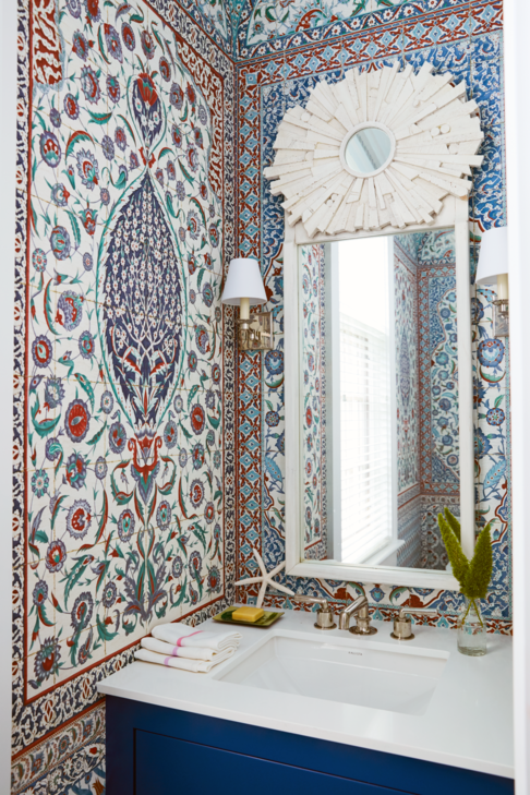"<p>Designer <a href=""https://reddkaihoi.com/"" target=""_blank"">Miles Redd</a> reinvents Bahamian-style with his fearless deployment of rich patterns and vivacious shades throughout this Baker's Bay retreat. An ornate <a href=""https://www.iksel.com/"" target=""_blank"">Iksel Decorative Arts</a> wallcovering transforms the small powder into a breathtaking design moment, sure to be the talk of this sun-drenched home. The sconces are from <a href=""https://www.visualcomfort.com/"" target=""_blank"">Visual Comfort & Co</a>.</p>"