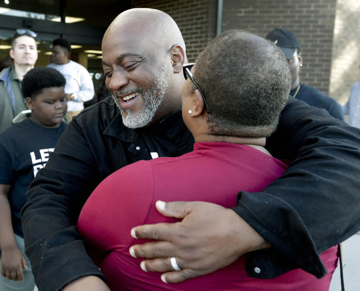 Former felon Desmond Meade and president of the Florida Rights Restoration Coalition, left, hugs Melanie Campbell with the National Coalition Black Civic Participation, after registering to vote at the Supervisor of Elections office Tuesday, Jan. 8, 2019, in Orlando, Fla. Former felons in Florida began registering for elections on Tuesday, when an amendment that restores their voting rights went into effect. (AP Photo/John Raoux)