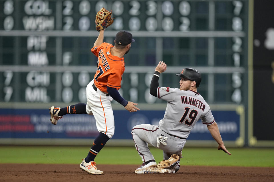 Arizona Diamondbacks' Josh VanMeter (19) looks back after being tagged out by Houston Astros second baseman Jose Altuve while trying to steal second base during the eighth inning of a baseball game Friday, Sept. 17, 2021, in Houston. (AP Photo/David J. Phillip)
