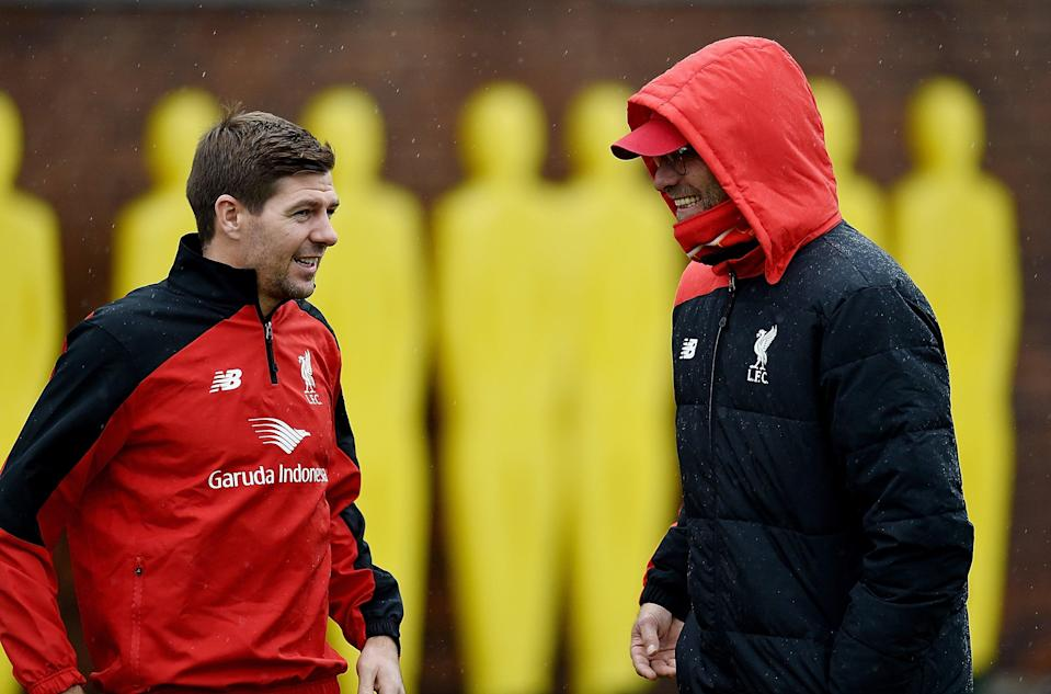 Steven Gerrard shares a conversation during the early stages of Jurgen Klopp's reign at AnfieldGetty