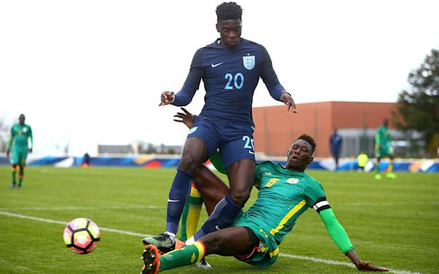 <span>Axel Tuanzebe in action for England </span> <span>Credit: The FA Collection </span>