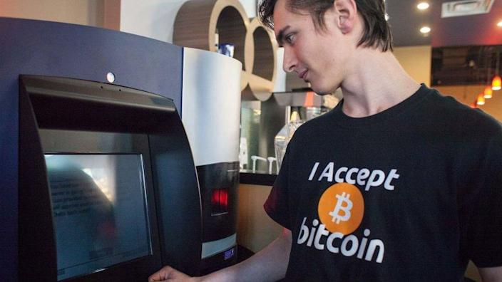 Gabriel Scheare uses the world's first bitcoin ATM on October 29, 2013 in Vancouver, British Columbia