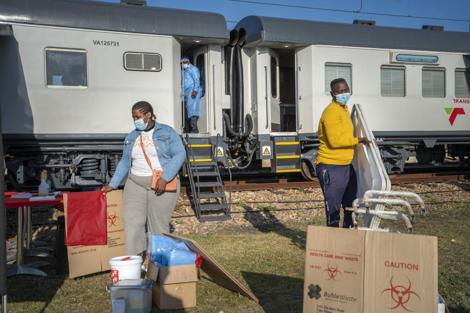 Medical personnel prepare the COVID-19 vaccination train parked at the Swartkops railroad yard outside Gqeberha, South Africa, for the arrival of patients Thursday Sept. 23, 2021. South Africa has sent a train carrying COVID-19 vaccines into one of its poorest provinces to get doses to areas where healthcare facilities are stretched. The vaccine train, named Transvaco, will go on a three-month tour through the Eastern Cape province and stop at seven stations for two weeks at a time to vaccinate people. (AP Photo/Jerome Delay)