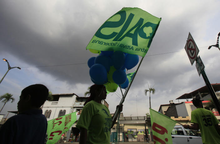 People attend a rally of Ecuador's President and candidate for re-election Rafael Correa, not in picture, in Guayaquil, Ecuador, Wednesday, Feb. 13, 2013. Presidential elections in Ecuador are scheduled for Feb. 17. (AP Photo/Dolores Ochoa)